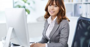 Business woman sitting in front of computer