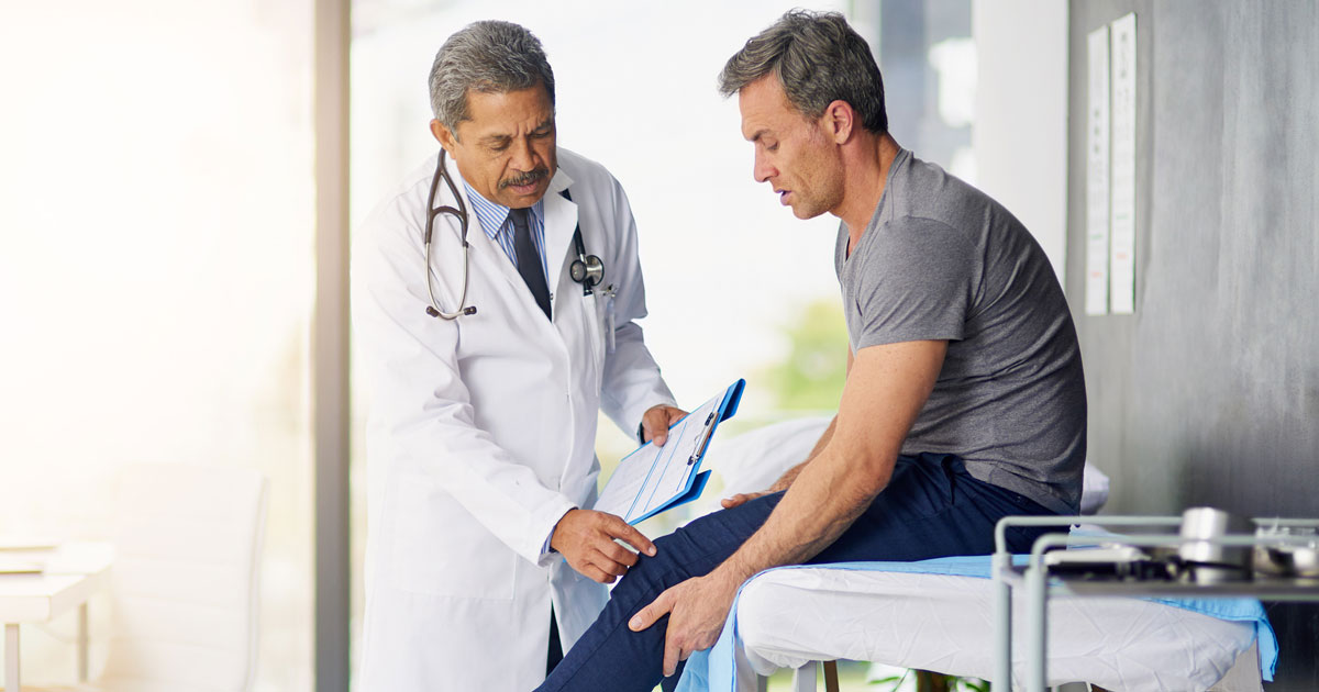 Man having knee examined by a doctor