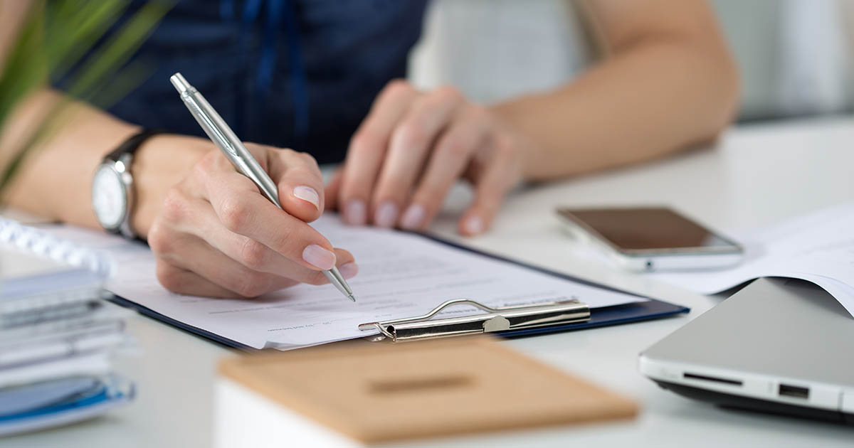 Person filling out paperwork