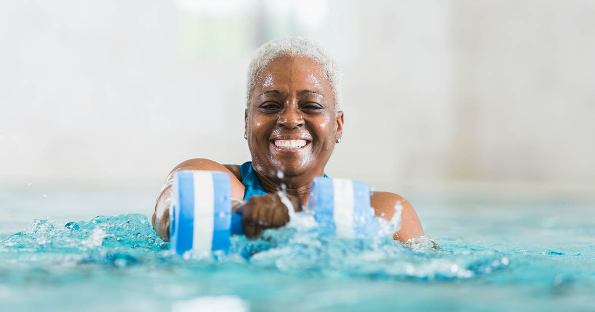 Senior woman exercising, doing water aerobics