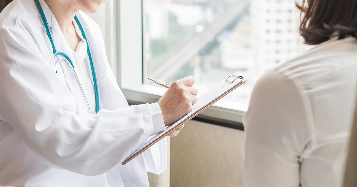 Doctor consulting and examining woman patient's health in medical clinic or hospital health service center