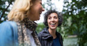 Two women talking in the park