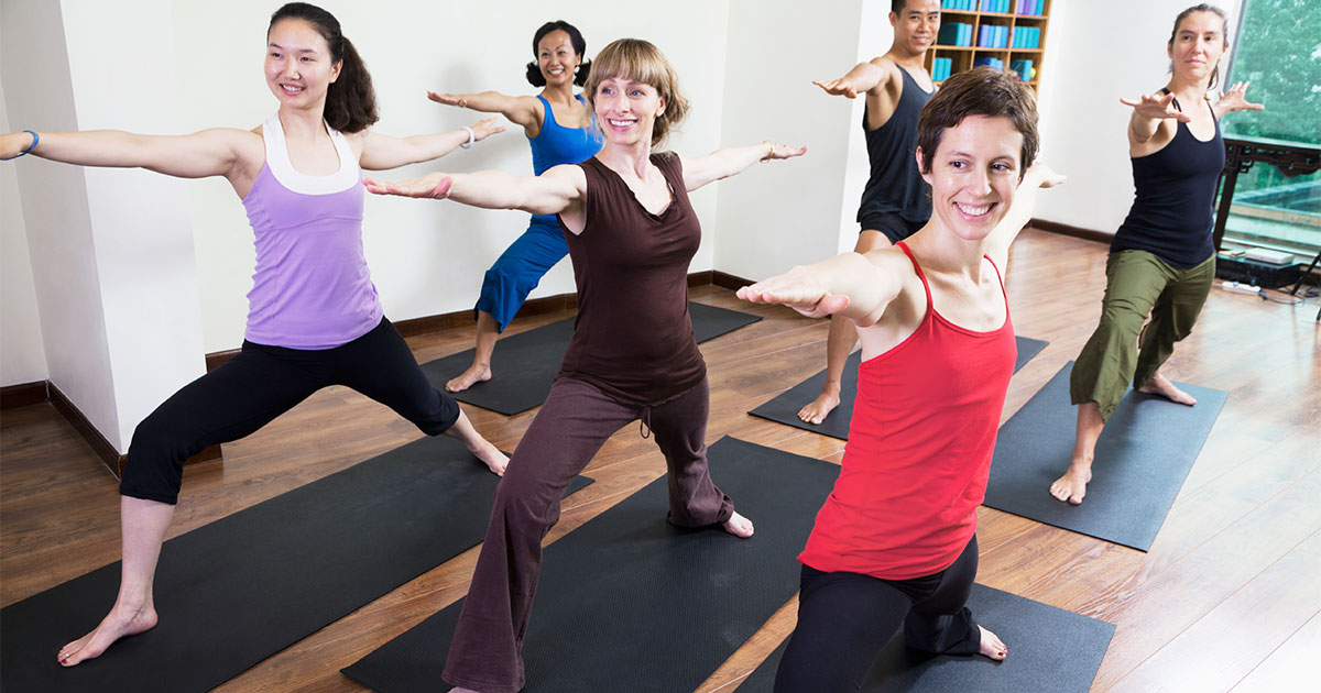 Women doing yoga indoors