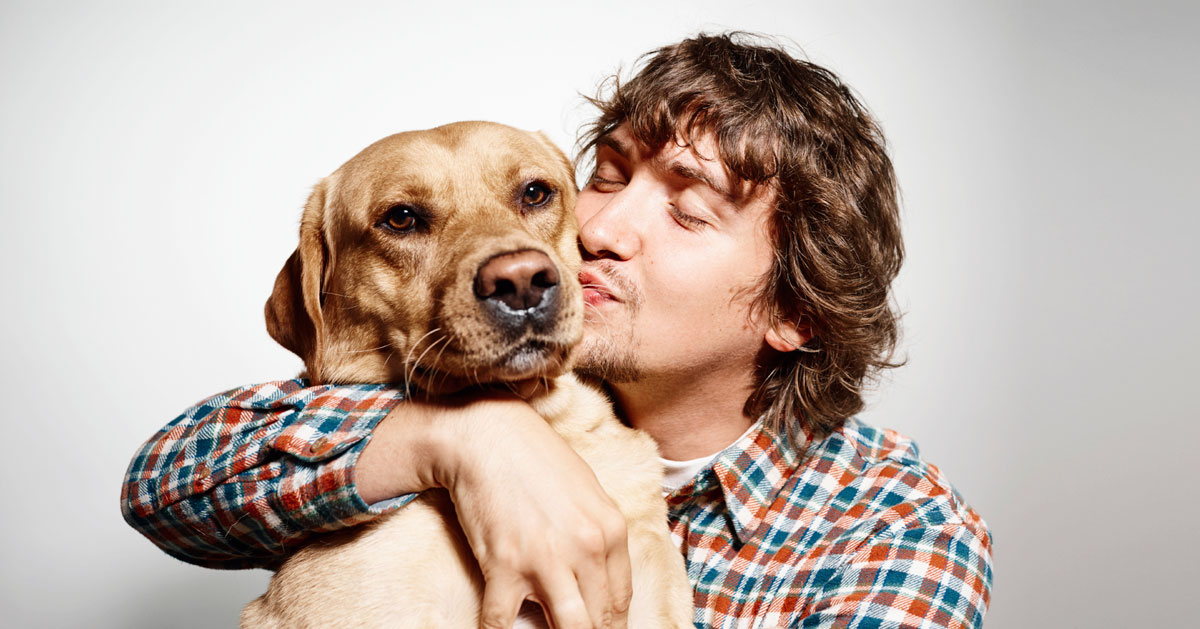 Man kissing his dog