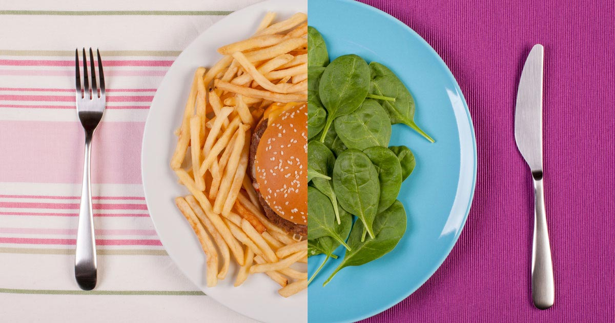 Split screen of plate, one half with hamburger and fries, other half with spinach